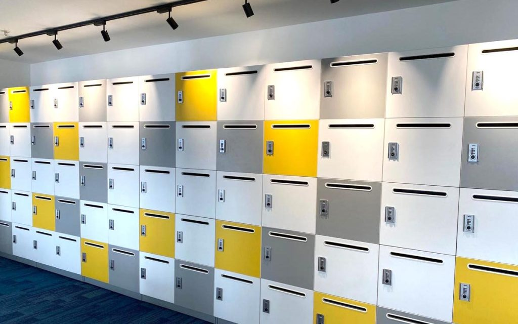 Ojmar Combi Combination lock on yellow and white lockers for office space