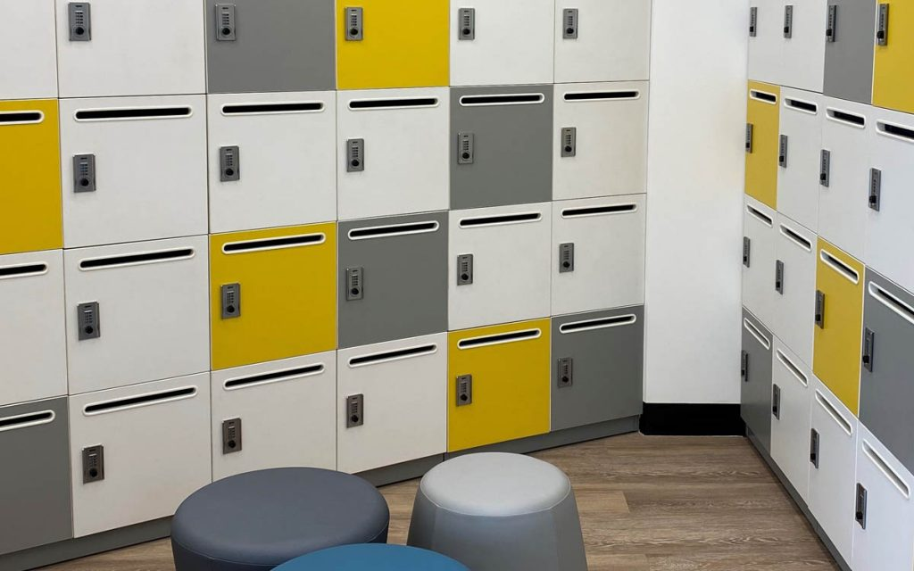 Ojmar Combi Combination lock on white and yellow lockers