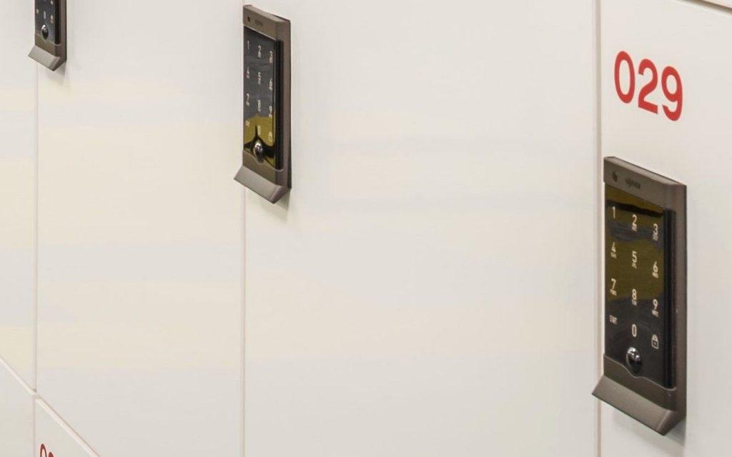 Ojmar black digital keypad lock on White lockers