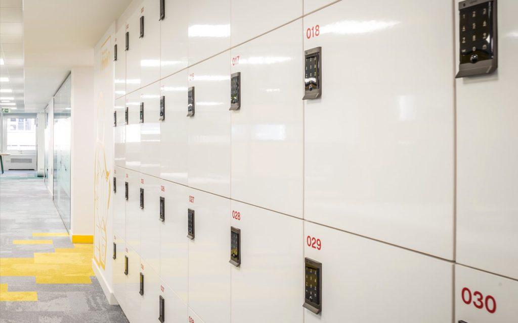 Ojmar Digital keypad black locks on white lockers for workspace