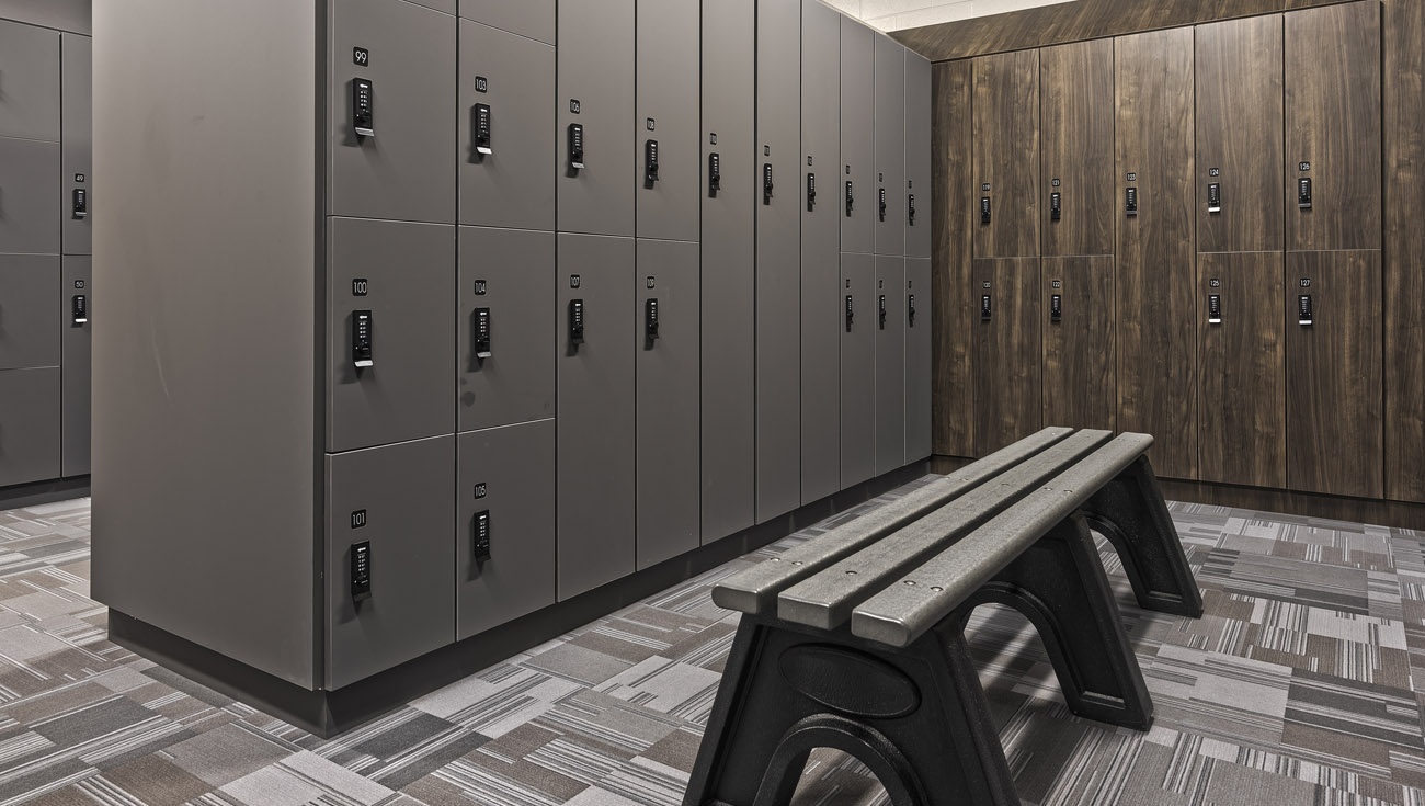 Ojmar Combi Pro combination lock on grey and wooden lockers