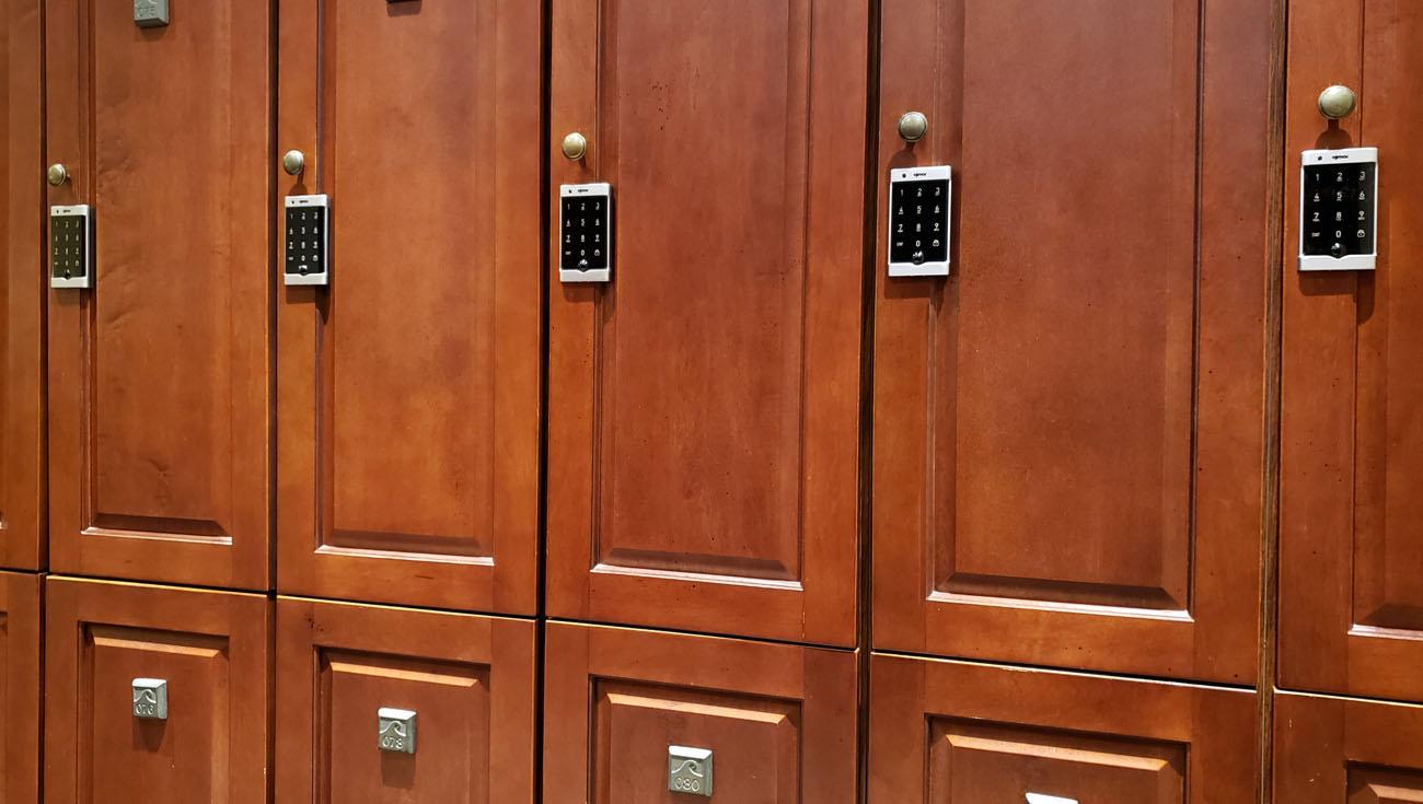 Ojmar Silver electronic Keypad lock on red wood lockers